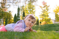 Girl on Grass in Park Royalty Free Stock Photo