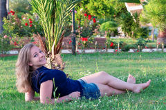 girl on the grass Royalty Free Stock Image