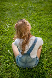 Girl on the grass Royalty Free Stock Photography