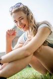 Girl on grass Stock Image