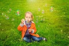 Girl grass soap bubbles Stock Photos
