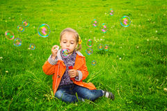 Girl grass soap bubbles Stock Photography