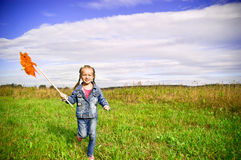 Girl on grass in summer  day Royalty Free Stock Images
