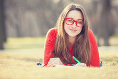 Girl on a grass. Stock Image