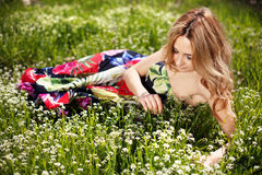 Girl in grass and wildflowers Royalty Free Stock Photography