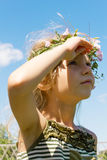 Girl in the grass wreath looking sky 4634 Royalty Free Stock Photos