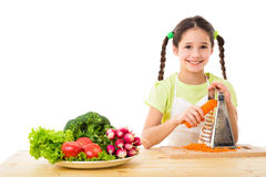 Girl grate the carrots Stock Image