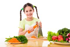 Girl grate the carrots Stock Photo