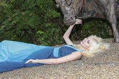 Girl on gravel Stock Images