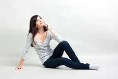 Girl on a gray background Stock Images