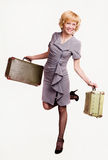Girl in gray with baggage Royalty Free Stock Image