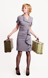 Girl in gray with baggage Stock Images