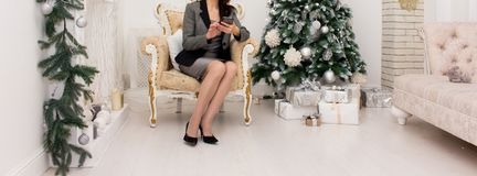 A girl in a gray business suit in a chair Royalty Free Stock Photos