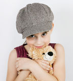 Girl in a gray cap Royalty Free Stock Photo