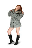 Girl in gray coat. On white background Royalty Free Stock Image
