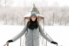 Girl in gray coat on a bridge in winter Royalty Free Stock Photography