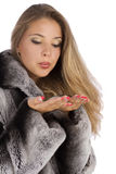 Girl in a gray coat with open hands palm. Attractive smiling woman in a gray coat with open hands palm for product Stock Photo