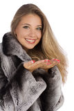 Girl in a gray coat with open hands palm. Attractive smiling woman in a gray coat with open hands palm for product Stock Photos