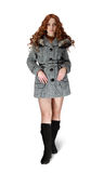 Girl in gray coat on white background. Woman in gray coat and black high shoes Royalty Free Stock Photo
