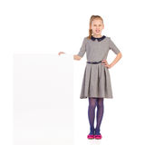 Girl in gray dress posing with a blank placard. Royalty Free Stock Photo