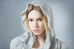 Girl in gray hood Royalty Free Stock Photo
