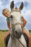 Girl and gray horse Royalty Free Stock Photos