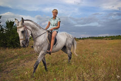 Girl and gray horse stock photography