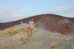 A girl on the Gray Hydrogen Volcano and Volcano Craters on Vulcano Island, Lipari, Italy. Sunset, Gas, Sulfur, Poisonous Pairs,. Evaporation royalty free stock images