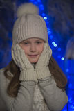 Girl in gray knit hat and gloves. Little girl in gray knit hat and gloves Royalty Free Stock Photo