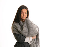 A girl in a gray knitted scarf sad. Royalty Free Stock Photos
