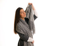 A girl in a gray knitted scarf thinking. Stock Images