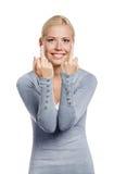 Girl showing vulgar gesture Royalty Free Stock Photography