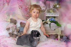 Girl with gray rabbit Royalty Free Stock Image