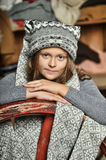 Girl in a gray sweater knitted hat Stock Image
