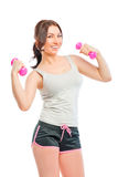 Girl in a gray t-shirt with dumbbells Stock Photos