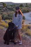 Girl with great dane pup. Girl posing with great dane pup, around sunset in Page Arizona Stock Photos