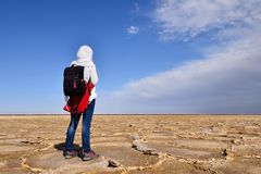 Girl on the Great Salt Desert in Iran. Iran, Tourist on the Great Salt Desert is a large desert lying in the middle of the Iranian plateau, Iran, near Khur Khor royalty free stock photography