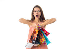 Girl with great surprise keeps itself in the hands of the packages is isolated on a white background Stock Photo