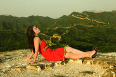 A girl on Great Wall. A girl is sitting on Great Wall in sunset time Royalty Free Stock Photography