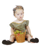 Girl in a greek fancy dress with pottle of fruit Royalty Free Stock Images