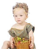 Girl in a greek fancy dress with pottle of fruit Royalty Free Stock Photos