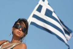 Girl and the greek flag. / Lighthouse Santorini Greece / Woman Natural Pose Stock Images