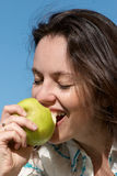 The girl with an green apple Royalty Free Stock Images
