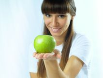 Girl with green apple Royalty Free Stock Image