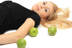 Girl with a green apple Stock Photos