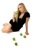 Girl with a green apple Royalty Free Stock Image