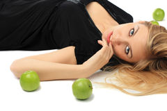 Girl with a green apple Stock Photos