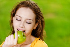 Girl with green apple Royalty Free Stock Images