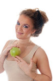 Girl with a green apple Royalty Free Stock Photography