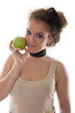 Girl with a green apple Stock Images